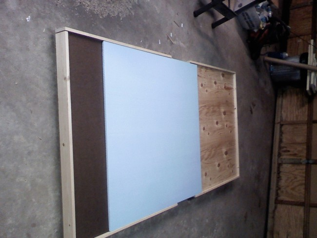 Tabletop laying flat, with particle board and foam on it